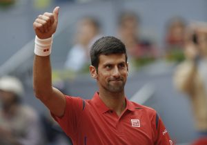 Novak Djokovic, from Serbia, celebrates after winning his match against Roberto Bautista, from Spain, during a Madrid Open tennis tournament in Madrid, Spain, Thursday, May 5, 2016. Djokovic won 6-2 and 6-1. (AP Photo/Francisco Seco)